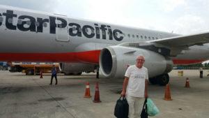 James deboards a plane