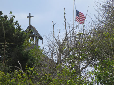 Church, flag and scotch broom